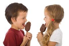 Cabritos que comen el helado Fotografía de archivo libre de regalías