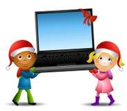 Cabritos que llevan el regalo de la computadora portátil Imagen de archivo libre de regalías