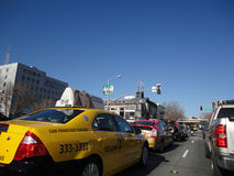 Cabs, Cars, and Trucks wait in traffic during red light Stock Image