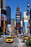 Cabs in Times Square. Times Square with the city's well known yellow cabs on a sunny day.  Times Square is, a very popular tourist attraction a symbol of New Royalty Free Stock Images