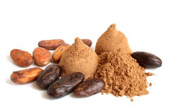 Cacao beans, cacao powder and chocolate sweets Royalty Free Stock Image
