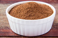 Cacao in ceramic bowl. Cacao in white ceramic bowl Royalty Free Stock Photo