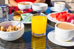 Cacao, juice, muesli and fruits for breakfast at a Royalty Free Stock Photos