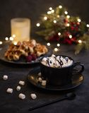 Cacao marshmellow belgian waffels candles christmas hugge cozy home royalty free stock photography