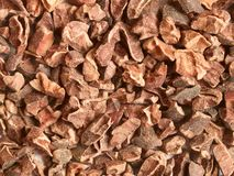 Cacao nibs. Raw cacao nibs; close-up; can be used as a background royalty free stock image