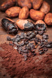 Cacao nibs. On old wooden background stock photos