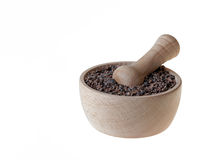 Cacao nibs in pestle. Organic cacao nibs in wooden pestle isolated on white Stock Images