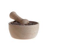 Cacao nibs in pestle on white. Organic cacao nibs in wooden pestle isolated on white Stock Image