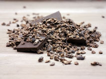 Cacao nibs raw crushed beans. Organic cacao nibs, crushed cacao beans which are highly nutrient, combined with pure chocolate chunks Royalty Free Stock Photo