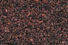 Cacao nibs. On white background royalty free stock photography