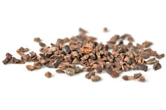 Cacao nibs on white background. Isolated royalty free stock photo