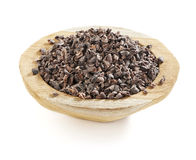 Cacao nibs in a wooden bowl Royalty Free Stock Images