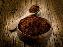 Cacao powder. On wood bowl stock images