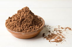 Cacao powder with in a bowl stock photos