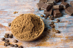 Cacao powder in a bowl with chocolate and cinnamon royalty free stock images