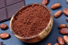 Cacao powder in a bowl with chocolate stock image
