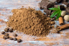 Cacao powder with chocolate and cinnamon stock images