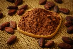 Cacao powder and cocoa beans on burlap stock photos
