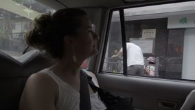Cacausian female tourist in a Chinese cab. View of a cacausian female tourist in a Chinese cab stock footage