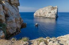 Caccia cape, Sardinia. Isolated rock at the sea near the Caccia cape in Sardinia Stock Photography