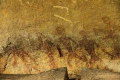 Caccia umana sulla parete dell'arenaria fotografia stock libera da diritti