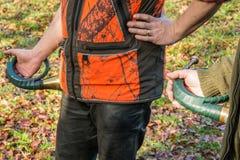 Cacciatore con il corno da caccia Fotografia Stock