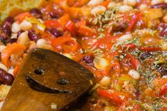 Cacciatore cooking on progress. With a smile kitchen spoon Royalty Free Stock Images
