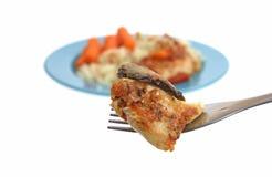 Cacciatore del pollo en fork Imagen de archivo libre de regalías