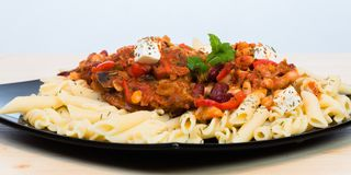 Cacciatore served on a black plate Royalty Free Stock Images