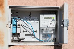 Open electric panel and meter in a street in Caceres, Extremadura, Spain. stock image