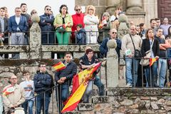 Attendants with flags of Spain to the meeting of Vox, the far right party, with its leader Santiago Abascal in Caceres. Caceres, Extremadura, Spain - May  18 royalty free stock photography