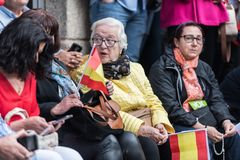 Attendants with flags of Spain to the meeting of Vox, the far right party, with its leader Santiago Abascal in Caceres. Caceres, Extremadura, Spain - May  18 royalty free stock image