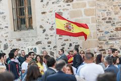 Attendants with flags of Spain to the meeting of Vox, far right Spanish party, with its leader Santiago Abascal. Caceres, Extremadura, Spain - May  18, 2019 stock images