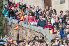 Attendants with flags of Spain to the meeting of Vox, the far right Spanish party, with its leader Santiago Abascal. Caceres, Extremadura, Spain - May  18, 2019 stock photos