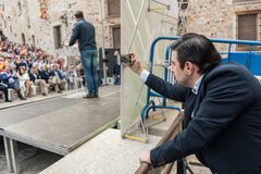 A man takes a photograph of the intervention of the leader of the extreme right-wing Vox party, Santiago Abascal. Caceres, Extremadura, Spain - May  18, 2019:  A royalty free stock images