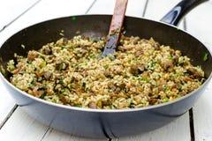 Cacerola con arroz Imagenes de archivo