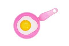 Cacerola plástica del juguete y huevo frito Fotografía de archivo libre de regalías
