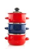 Cacerolas rojas y azules Imagen de archivo libre de regalías