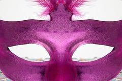Caché derrière le masque Images stock