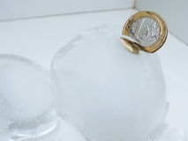 Cache euro coins in ice. Stock Photography