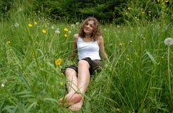 Cachez dans l'herbe Images libres de droits