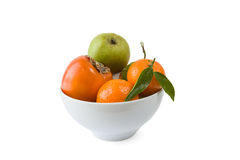 Cachi, mandarino e pera in un piatto Fotografia Stock