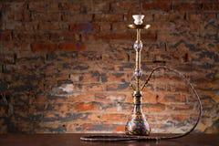 Cachimba del este en la tabla de madera Foto de archivo