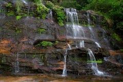 Cachoeira azul das montanhas imagem de stock royalty free
