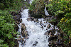 Cachoeira bonita de Oltschibach, Unterbach, a municipalidade de Brienz Imagem de Stock