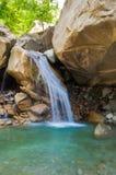Cachoeira da montanha em antecipação à chuva Fotografia de Stock