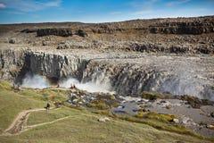 Cachoeira de Dettifoss em Islândia sob um céu azul do verão com clou Fotografia de Stock Royalty Free