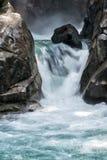 Cachoeira italiana das dolomites dos cumes no por do sol em Val di Genova Fotografia de Stock