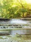 Cachoeira na luz do sol morna Imagens de Stock Royalty Free