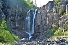 Cachoeira nas rochas Foto de Stock Royalty Free